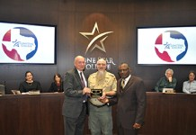 The 2018 Spirit of Scouting Award was presented to Lone Star College for making its facilities and equipment available to the Boy Scouts of America Tall Timbers District. Pictured standing (left to right) are Dr. Steve Head, LSC chancellor; Stuart Schroeder, Tall Timbers District vice chairman; and Dr. Alton Smith, LSC Board of Trustees chair. (LSC courtesy photo)