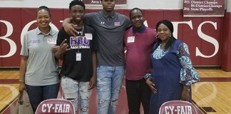 Cy-Fair High School senior basketball player Zachary Iyeyemi (center) poses with family after signing his letter of intent April 17 to Houston Baptist University. (CFISD courtesy photo)