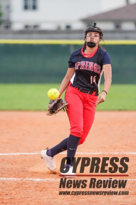 Cy Springs freshman Ava Garibav launches a pitch during the Lady Panthers' battle with Bryan Friday night. (Cypress News Review photo by Creighton Holub)