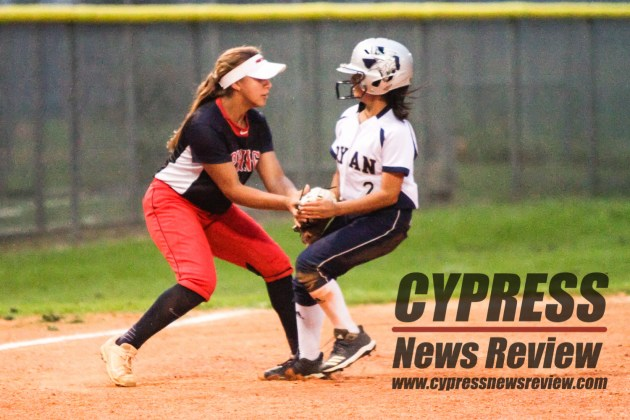 Edriani Berges (#11) tags a Bryan baserunner out during the Lady Panthers' battle with Bryan Friday night. Left fielder Danielle Morales had just caught a left field fly and connected with Berges. (Cypress News Review photo by Creighton Holub)
