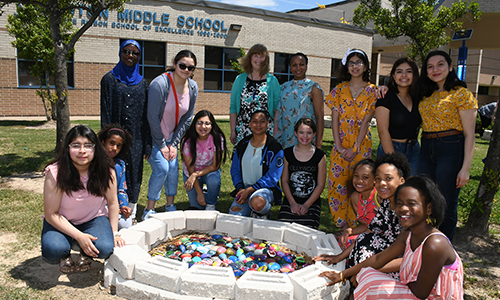 Current and former members of Thornton Middle School's Butterfly Defenders Club gather by the rock garden that is part of the campus' monarch butterfly garden, made possible by a $3,800 grant from the North Harris County Branch of the American Association of University Women (AAUW). (CFISD courtesy photo)