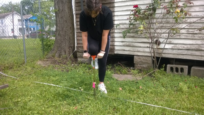 Lone Star College-CyFair student Emily Massey uses a soil probe to recover core samples at the Freedmen's Town archaeology project. (LSC courtesy photo)