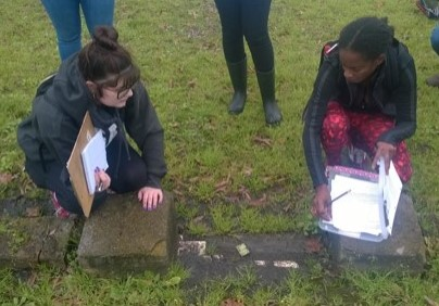 Lone Star College-CyFair students Emily Massey, left, and Jasmine Lee record the entry to a family burial plot at the Olivewood Cemetery. (LSC courtesy photo)