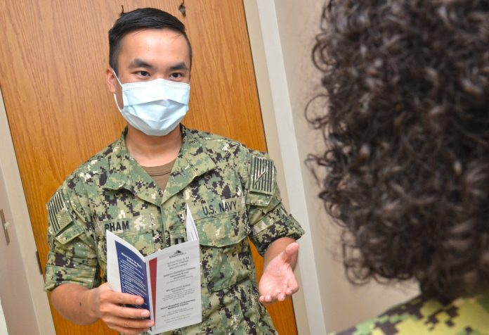 """JACKSONVILLE, Fla. (Sept. 14, 2020) – Lt. Gia Han Pham, a resident family medicine physician at Naval Hospital Jacksonville, provides tobacco counseling to a patient. Pham, a native of Cypress, Texas, holds a Doctor of Osteopathic Medicine degree from Texas College of Osteopathic Medicine. """"Tobacco cessation is perhaps one of the biggest investments one can make in overall health. It drastically decreases heart attack and stroke risk, and pays dividends for years to come -- with improved blood pressure control, lung function, quality of life, and so much more. It's never too late to quit. When you're ready, our staff are here to help!"""" NH Jacksonville's Wellness Center offers tobacco cessation counseling, classes, medication, and gum. The time is now, to be tobacco-free. (U.S. Navy photo by Jacob Sippel, Naval Hospital Jacksonville/Released)."""