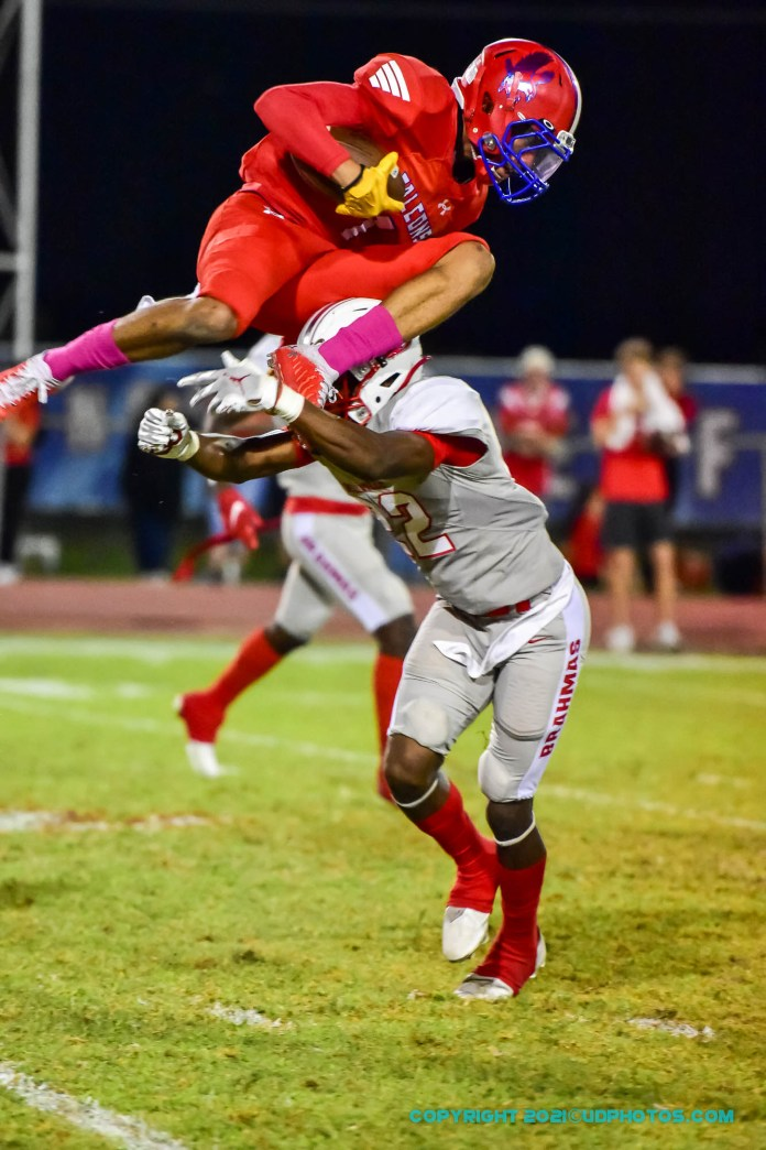 Brookshire Royal Falcon receiver DaShawn Adams (1) tries to hurdle a Bellville Brahma defender after making a catch on Friday night, Oct. 22, 2021. (Photo courtesy Terry Carter, UDPhotos.com)
