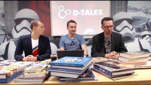 Jorn, Ralf en Michiel zittend achter stapels van hun favoriete Disneyboeken