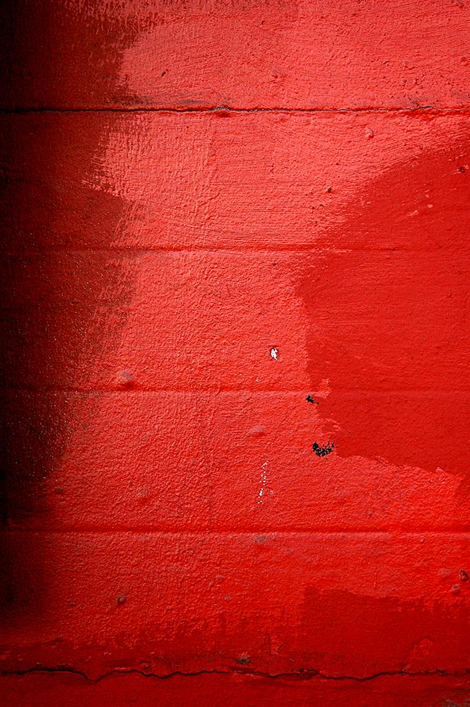 Abstract color photograph featuring red, black and white.