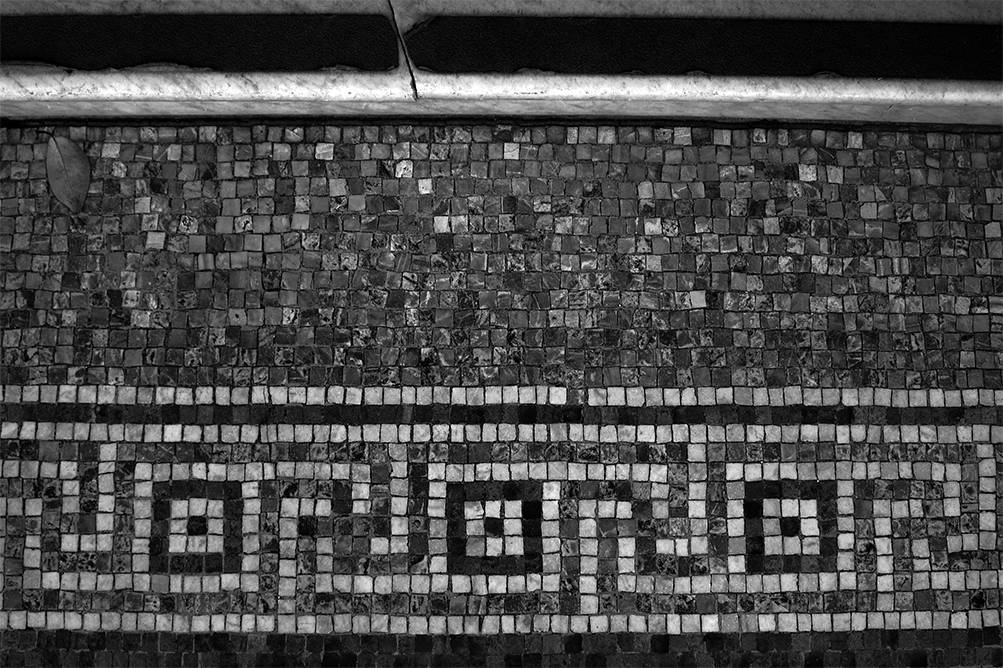 black and white photograph of antique mosaic tiles.