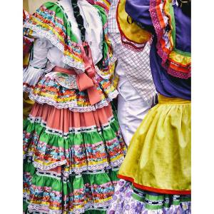 Dancers wearing colorful traditional dresses in Libano, Colombia.