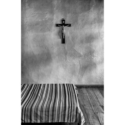 A crucifix adorns the wall of a bedroom in Murillo, Colombia.