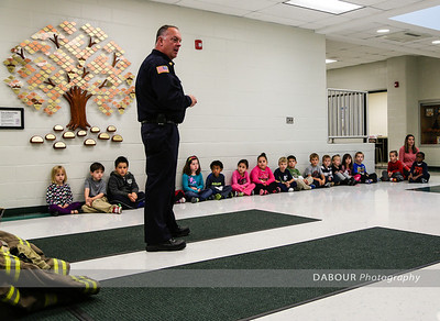 Members of the Stewartsville Fire Co visit the Greenwich Elemantary School for their annual Fire Prevention instruction.  Due to the rain it took place in the school lobby this year. Photo by | DAVE DABOUR