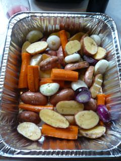 Mixed root vegetables in a foil pan