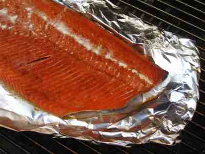 Side of grill smoked salmon on a sheet of foil