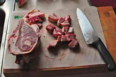 Cutting lamb shoulder chops into cubes