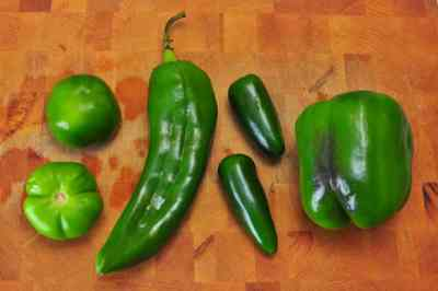 L to R: Tomatillo, Anaheim pepper, Jalapeno pepper, Green Bell Pepper