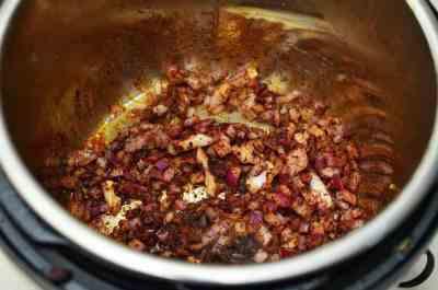 Sauté the onions and chili powder