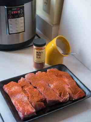 Ribs, sprinkled with salt and rub, ready for the pressure cooker