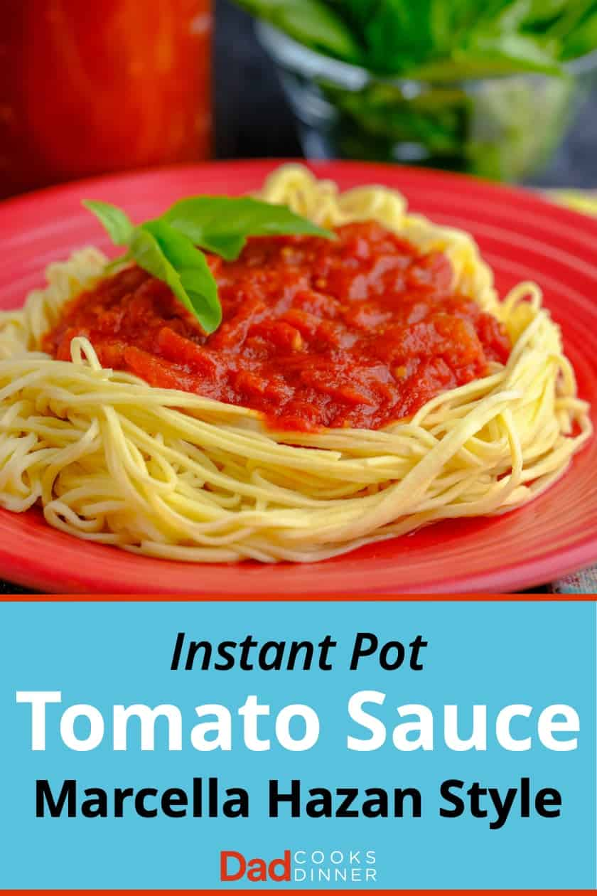 Tomato sauce over spaghetti noodles, with a piece of basil, on a red plate, with text Instant Pot Marcella Hazan Tomato Sauce below it
