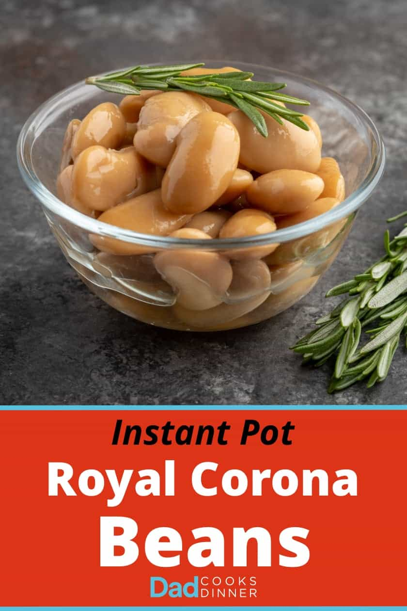 A bowl of cooked royal corona beans with a sprig of rosemary on top and on the table next to them