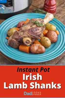 A braised lamb shank, surrounded by potatoes and carrots, on a teal plate, with an Instant Pot, a bundle of thyme, and a pepper mill in the background