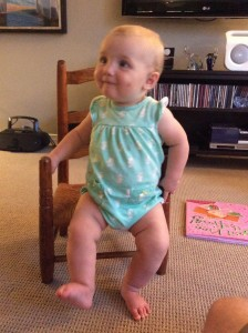 Baby sitting in a small chair