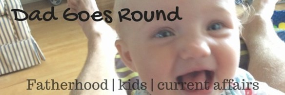 """Image of a smiling baby with text """"Dad Goes Round - Fatherhood, Kids, Current Affairs"""""""