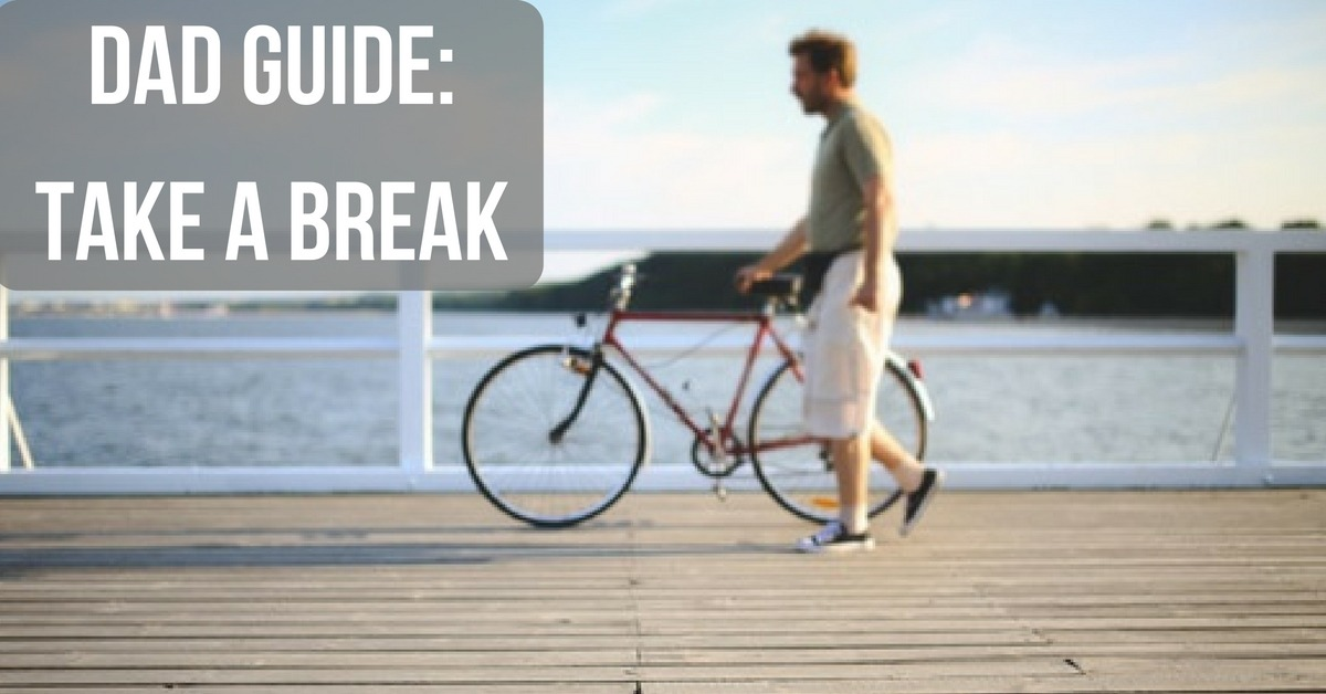 "Image of a mad walking a bike on a boardwalk with text ""Dad Guide: Take a Break"""