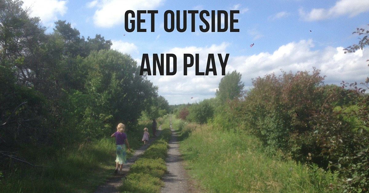 "Image of three kids walking a farm road with text ""Get Outside and Play"""
