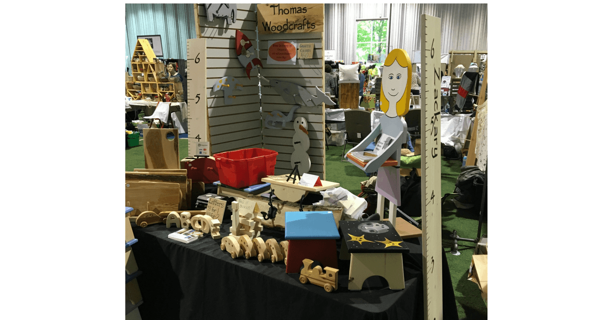 Image of a craft show booth for Thomas Woodcrafts