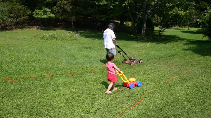 daddy's girl mows with daddy