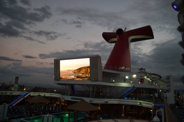 Carnival Sunshine whale tail at sunset in San Juan Spring 2018