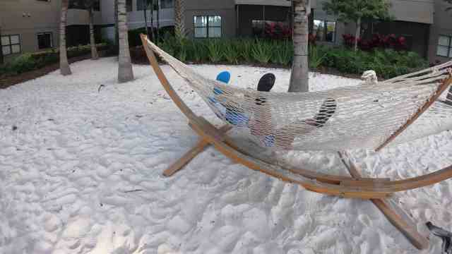 The Grove Resort Orlando Review - Amenities - Wife and Son Trying Hammock Cove