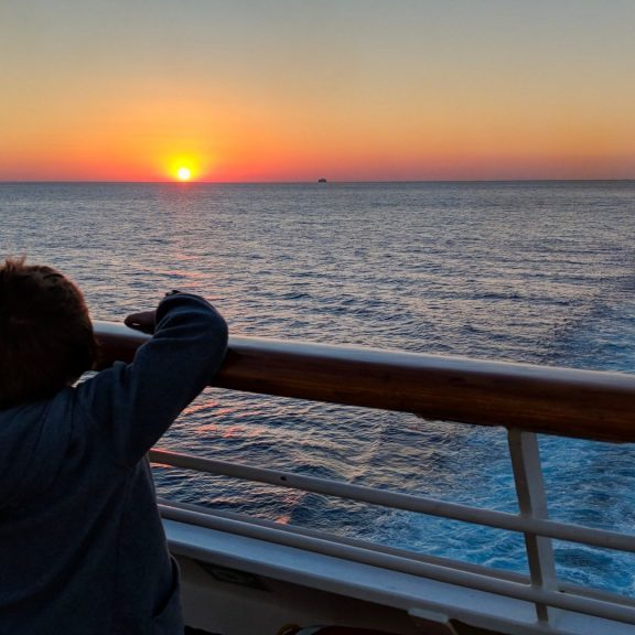 My son on the Carnival Sunshine Ship at Sunset