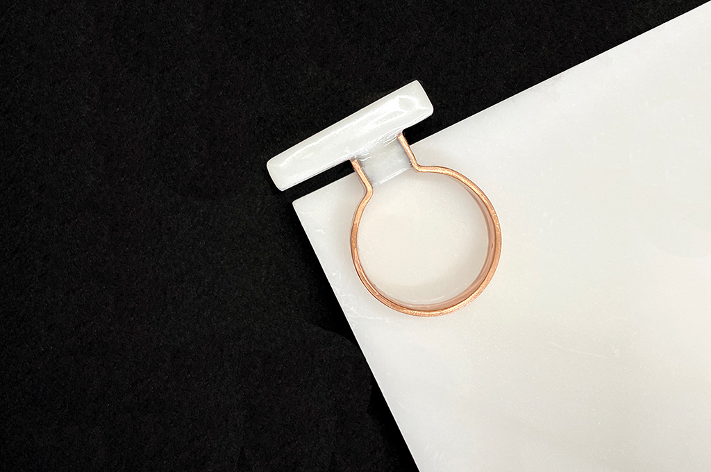 Marble on copper ring