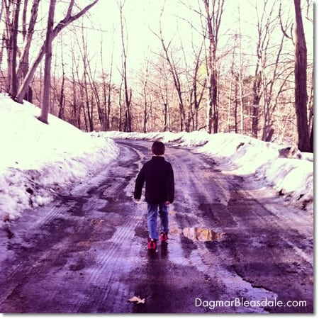 boy taking a walk on snowy road