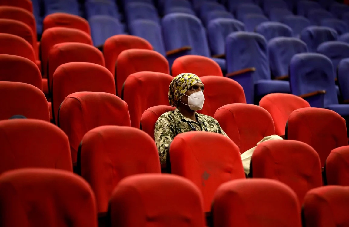 A man waits after receiving a dose of COVISHIELD, a COVID-19 vaccine manufactured by the Serum Institute of India, in an auditorium, which has been converted into a temporary vaccination center, in Ahmedabad, India, February 5, 2021. REUTERS / Amit Dave