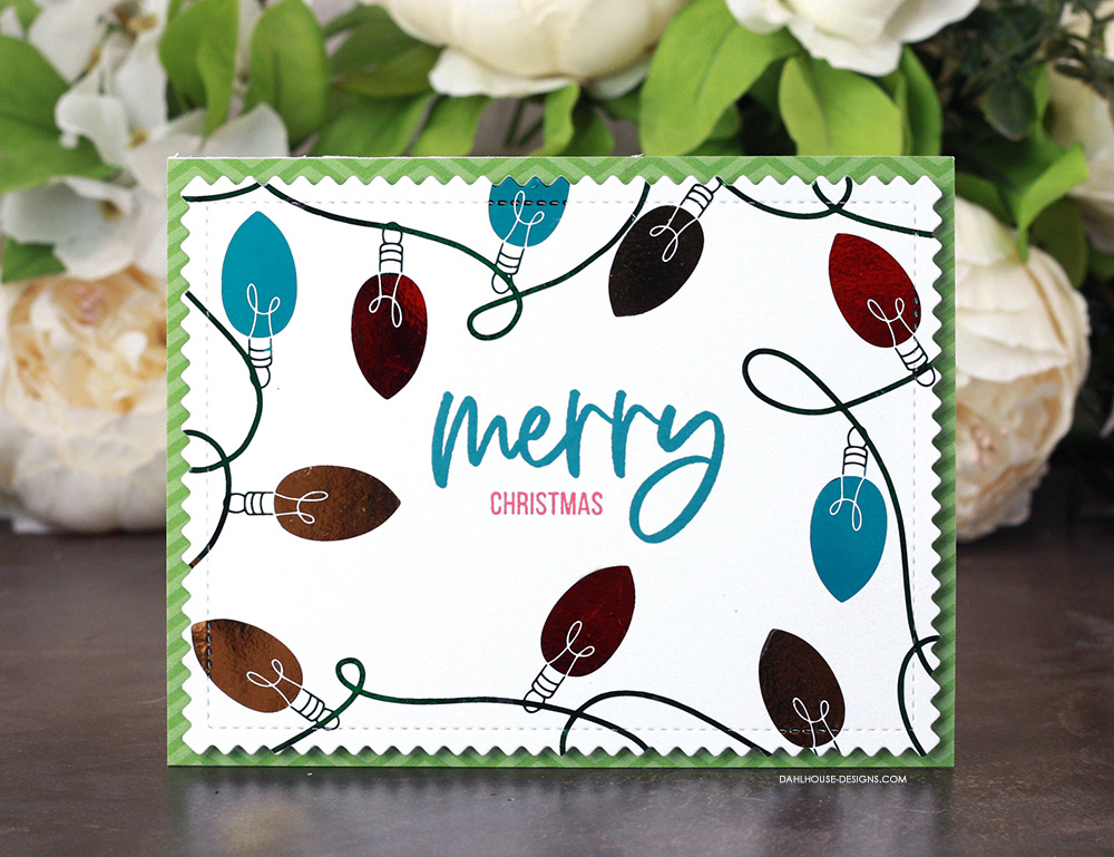 Sharing a fun Christmas card idea using toner sheets and foil with a tutorial & quick video. The images are from the Holiday Lights toner sheets and Heart of Christmas Unity Stamp Company stamp set. More inspiration on dahlhouse-designs.com. #cardmaking #cardmaker #cardmakingideas #cardinspiration #simplecards #stamping #dahlhousedesigns #unitystampco #handmadecards #diecutting #carddesign #cardtechnique #thermoweb #foiling #christmascards