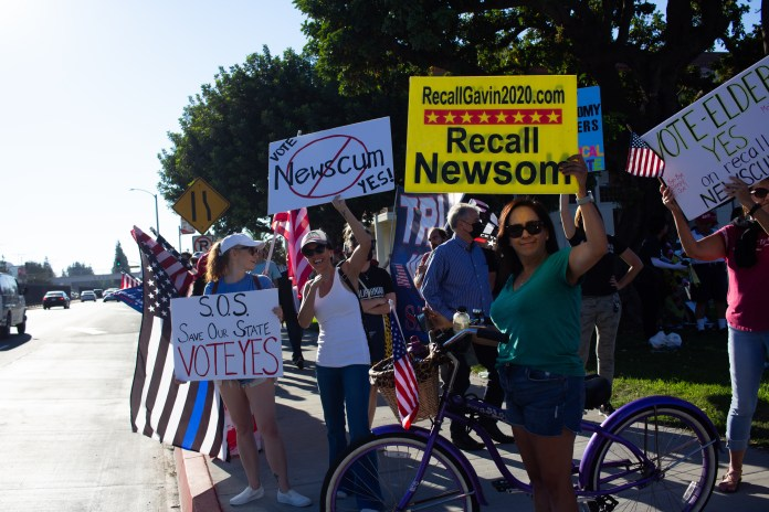 Partisan divisions on display near Long Beach City College before Biden, Newsom event
