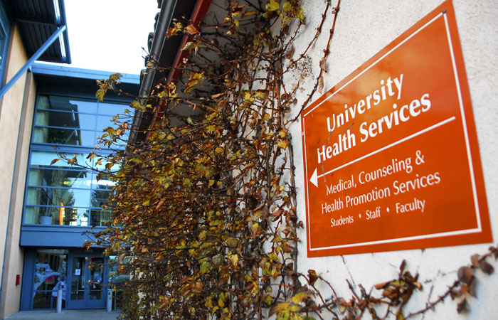 "A sign reading ""University Health Services"" points into the Tang Center, UC Berkeley's health center"