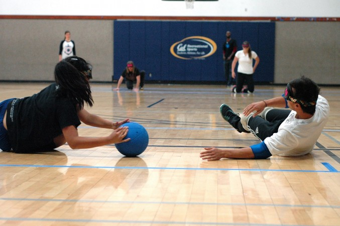 Goalball player blocking a shot