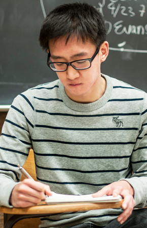 Ho Dong Chyung, a senior at UC Berkeley from Brazil, works in Barrows Hall before meeting for a group project.