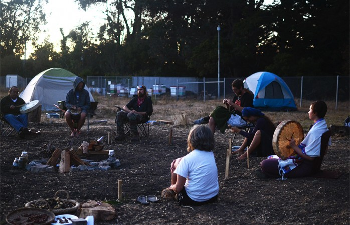 Members and supporters of the Indigenous Land Action Committee occupy the Gill Tract in October 2015 in protest of its development. They believe the land is sacred and belongs to the Ohlone tribe. Tracy Lam/File.