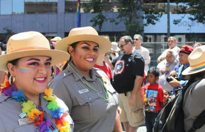 Parade participants grin with pride to the very end