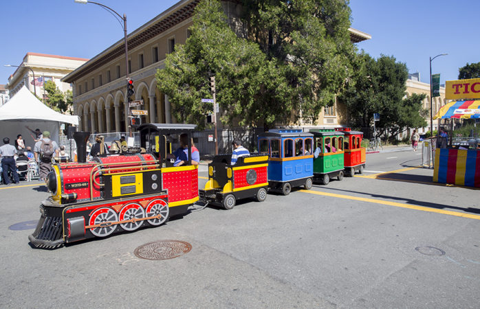 A train winds its way through the streets of Downtown Berkeley. Daniel Kim / Senior Staff