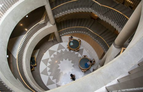 Image of the descending staircases of Main Stacks at UC Berkeley.