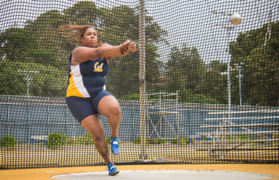 Track and Field athlete performs in her competition.