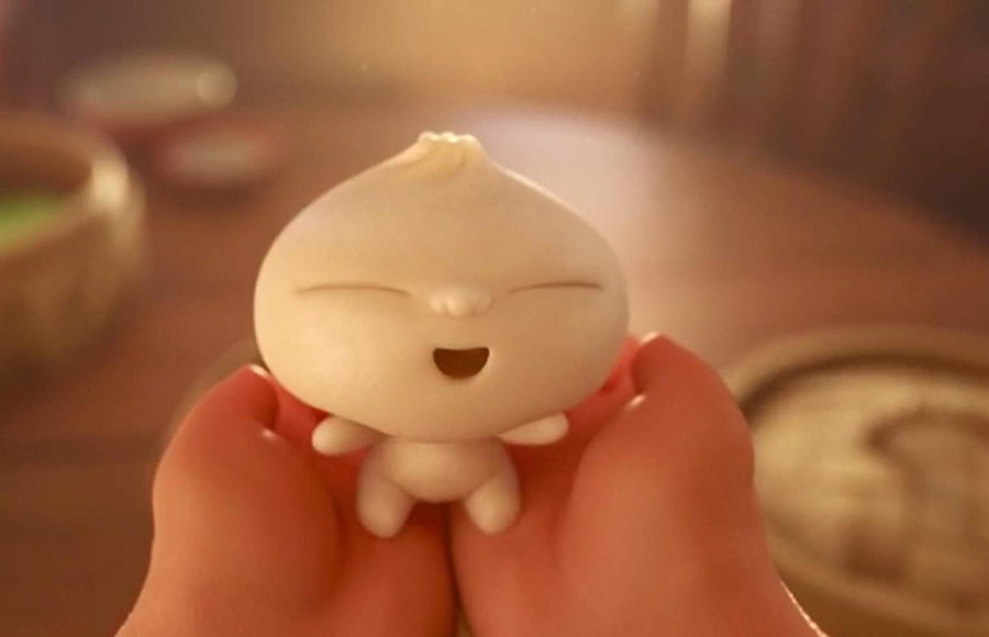 Hands holding an animated smiling dumpling.