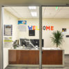 "An office inside of a building has colorful letters on the walls spelling ""welcome""."