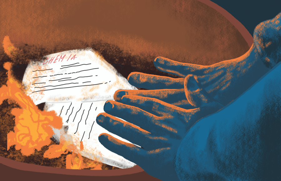 Hands warming over burning chemistry notes