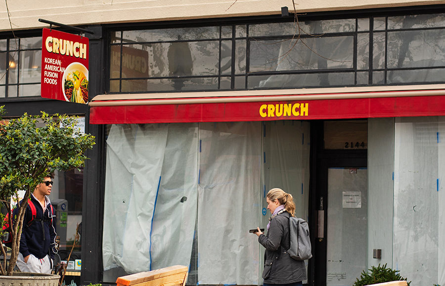"An abandoned establishment with a logo that reads ""Crunch""."